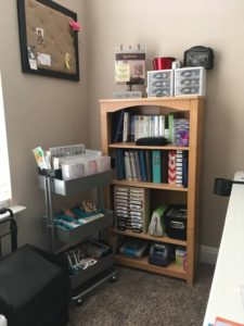 Rolling Cart Organization and bookshelf with Cricut cartridges, 6x8 albums, stamp ink pads, Cuttlebug, embossing plates