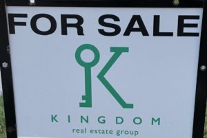 Making changes - a for sale sign in front of our house.