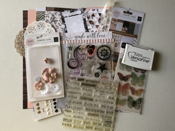 Mini scrapbook kit with patterned paper, cardstock, stickers, butterflies, doilies, enamel dots, flowers & stamps