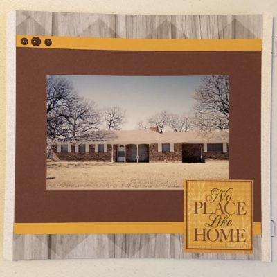 8x8 Scrapbook layout with woodgrain background paper, golden yellow & maroon mats, No Place Like Home sticker & enamel dots