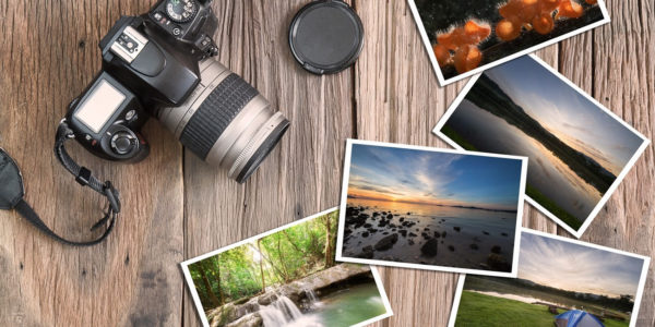 Camera & photos on a wood background; Love your photos