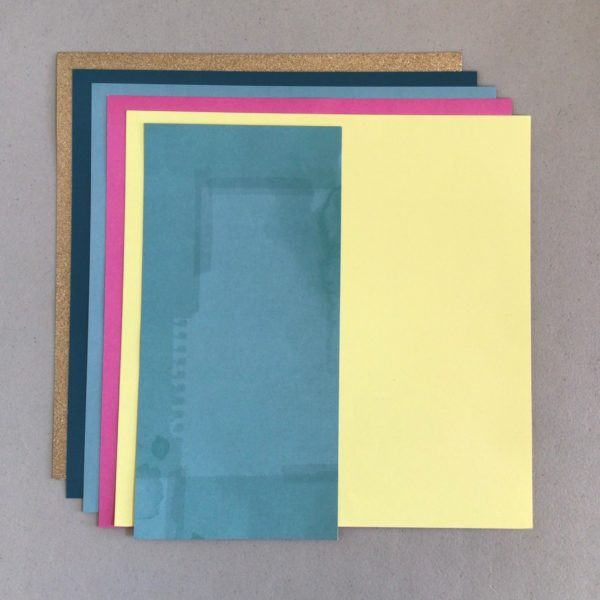 Scrapbook supplies; cardstock in gold, dark teal, light blue, pink and yellow - Counterfeit Kit October, 2021